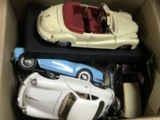 A box containing scale model cars.