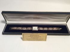 A H/M silver brooks and bentley footprint wrist watch.