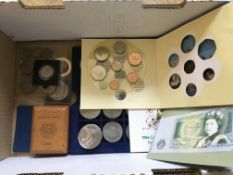 A box containing a collection of mixed commemorati