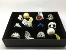 A collection of 12 silver rings, as new.