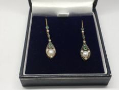 A boxed pair of drop earrings set with emeralds, p