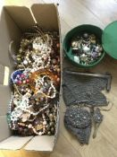 A box of costume jewellery including two mesh purs