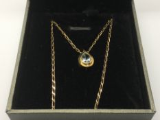 A 9ct gold and aquamarine set pendant and chain.