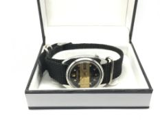 A Citizen automatic watch with black and gold tone