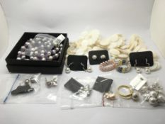 A collection of pearl and mother of pearl jeweller