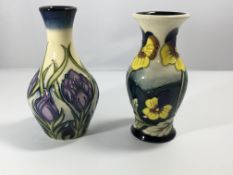 Two modern Moorcroft vases decorated with flowers