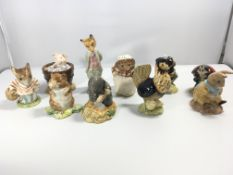 A collection of ten Beswick and Royal Albert Beatr