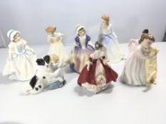 A collection of eight Royal Doulton porcelain figu