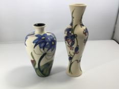 Two modern Moorcroft vases decorated with blue bel