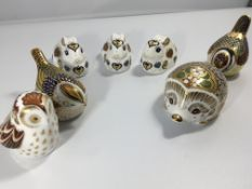 A collection of Royal Crown Derby porcelain orname