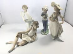 A collection of four Nao porcelain figures (one re