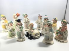 A collection of eleven Beswick clown figures most