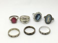 A collection of seven silver rings.