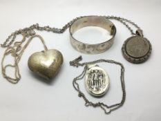 Three silver lockets, one in the shape of a heart