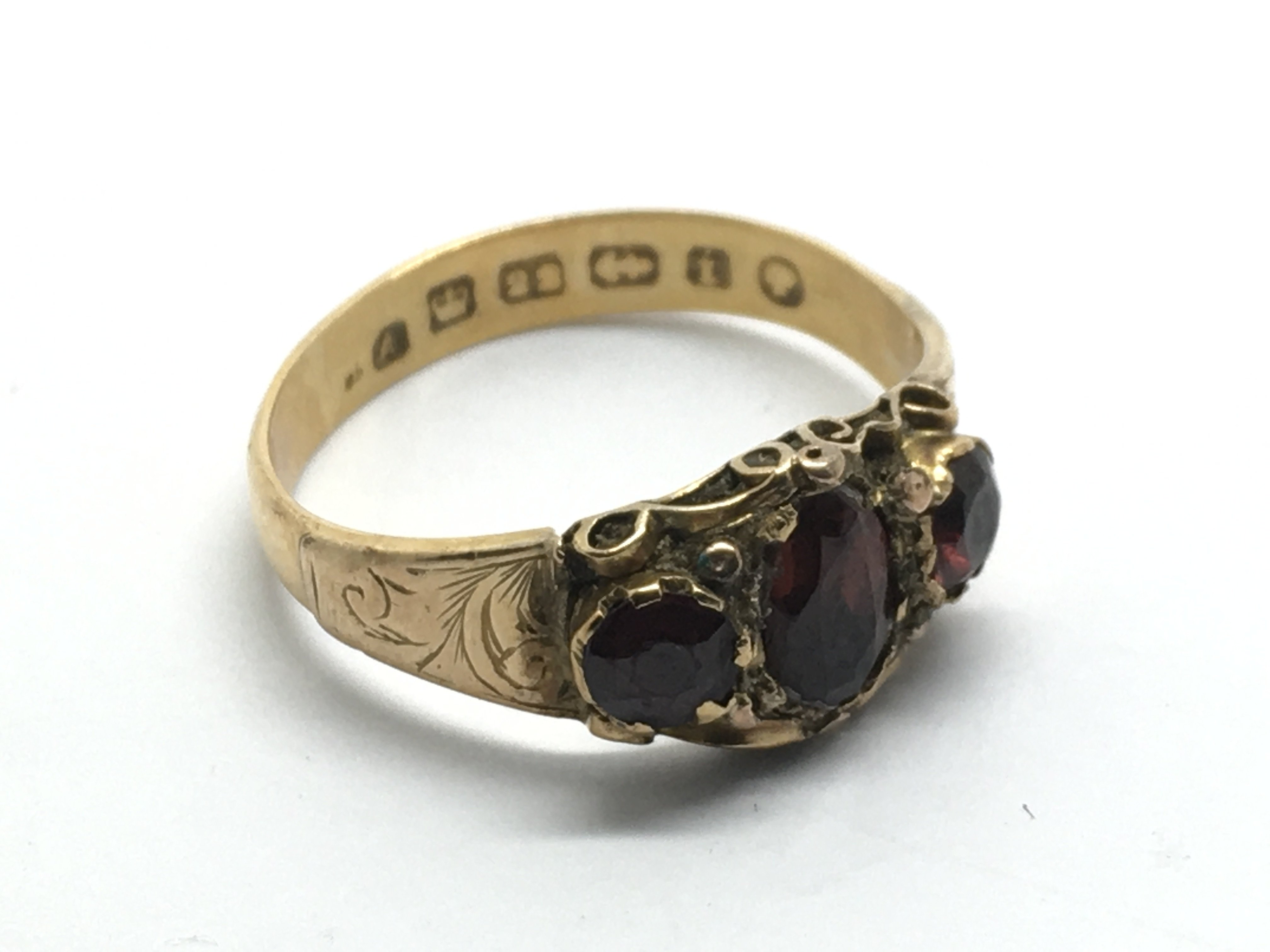 An antique 22ct gold ring inset with garnets, appr