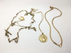 A gold necklace with a horseshoe pendant, a St Chr