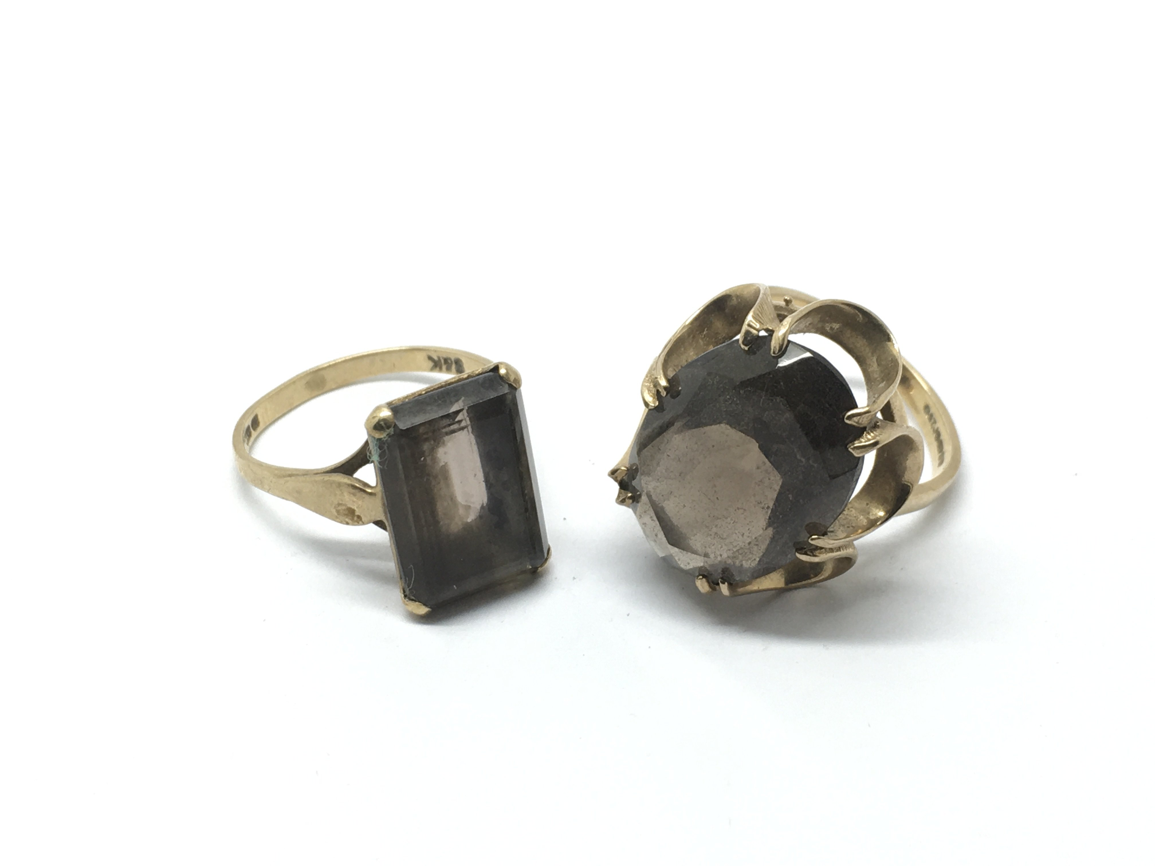 Two 9ct gold rings set with quartz stones, approx