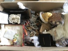 A box of costume jewellery and quartz watches.