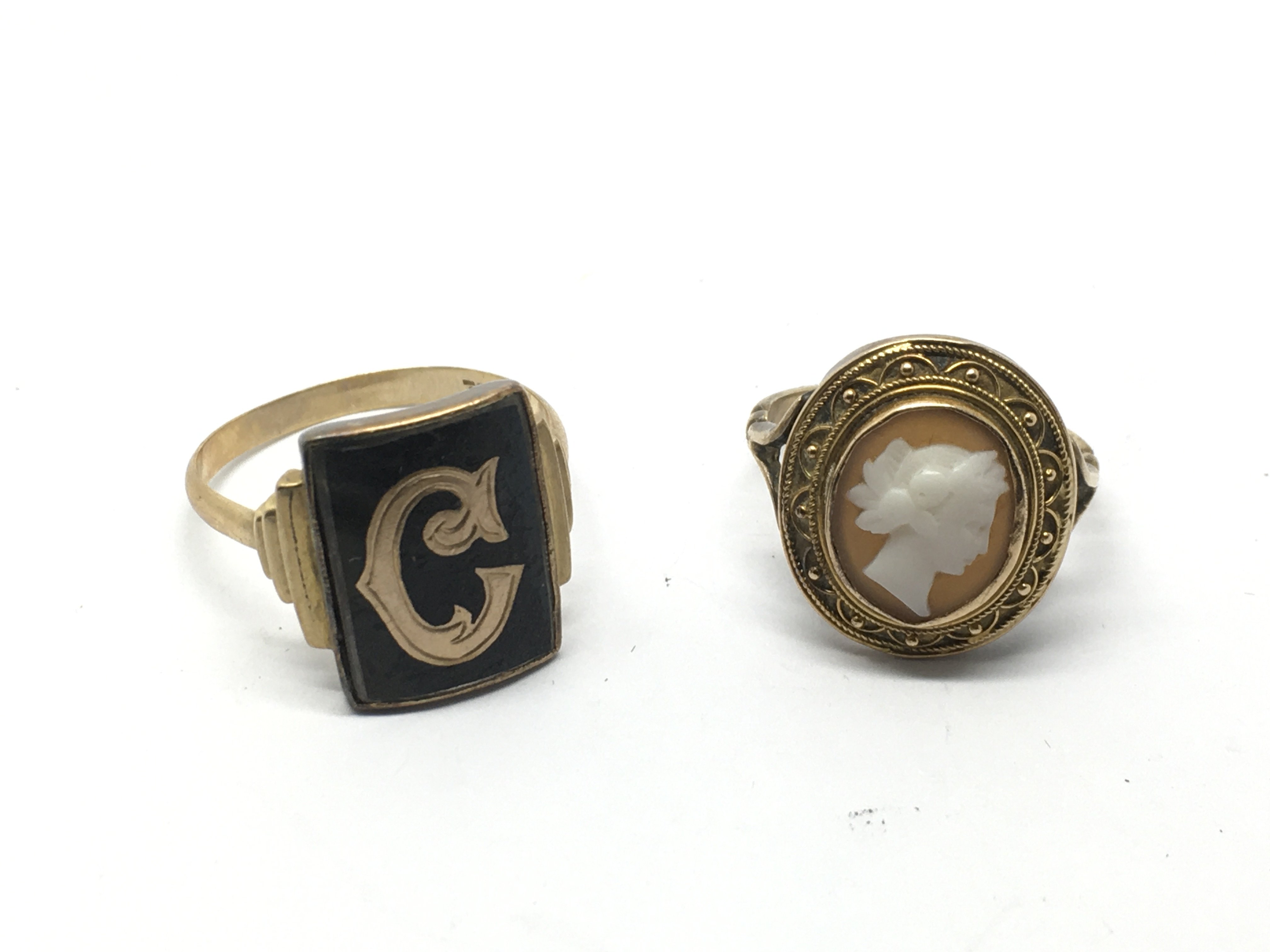 A 9ct gold black enamel ring and an unmarked gold
