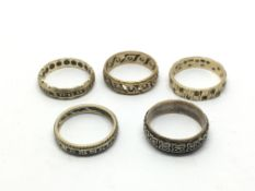 A collection of worn gold and silver eternity ring