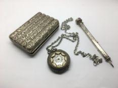 A white metal cigarette case, a silver dual pen an
