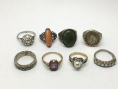 A collection of eight silver rings, various design