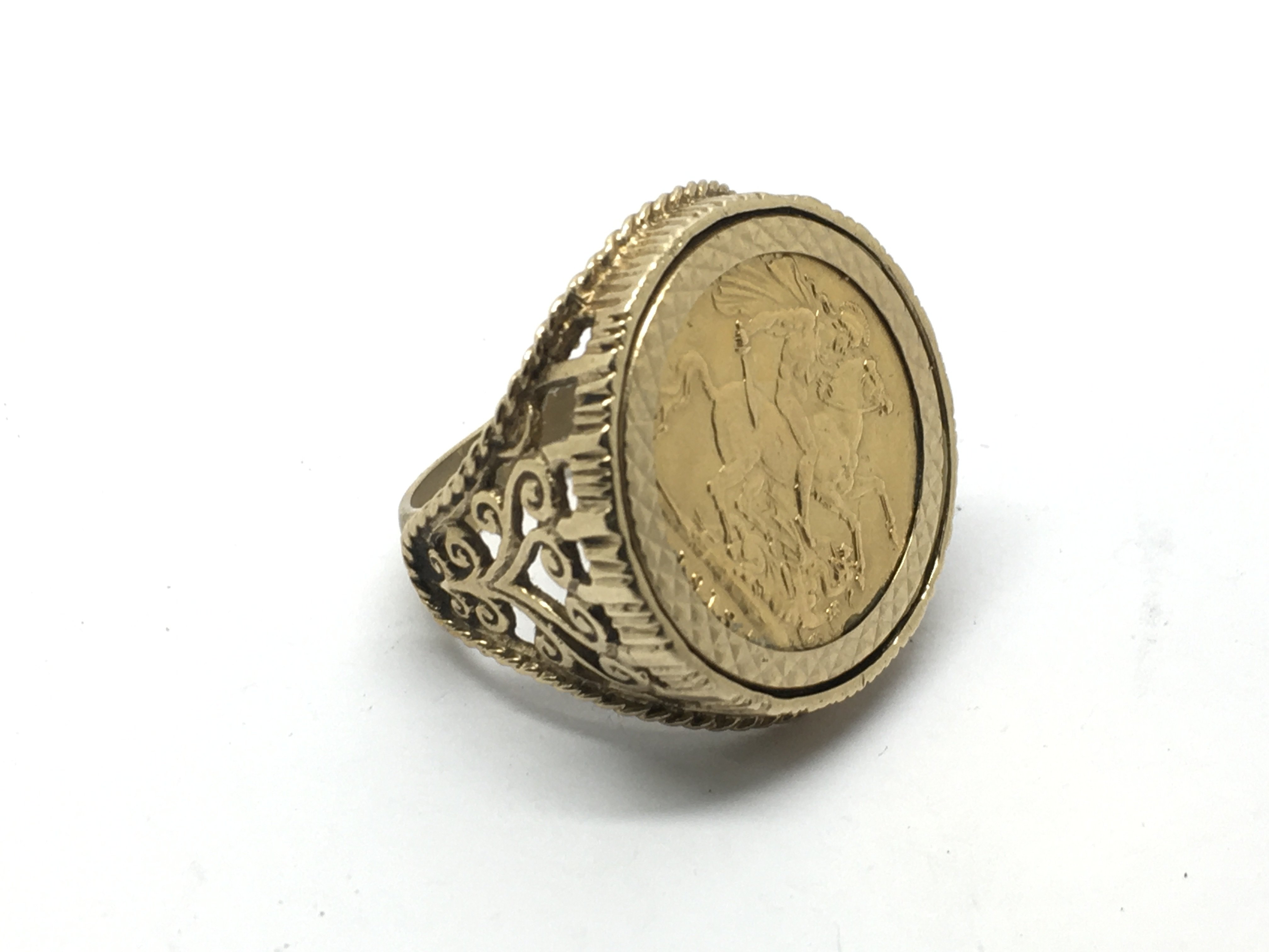 A 9ct gold ring inset with a full sovereign dated