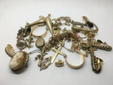 A collection of unmarked gold, gold earrings and o