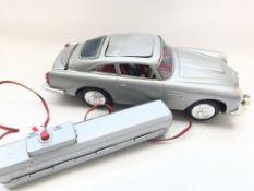 A Boxed Aston-Martin Secret Ejector R/C Car boxed.