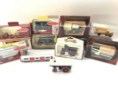 A collection of boxed Corgi and matchbox vans/ lor