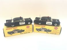 Two boxed Dinky U.S.A. police cars, one box is a r