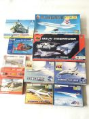 A collection of model kits of aeroplanes and helic
