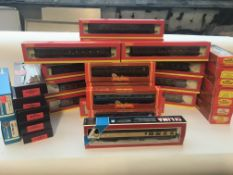 A collection of Hornby Boxed coaches Approximately