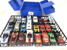 A Matchbox cary case with matchbox cars.