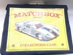 A Matchbox Series Collectors case and cars.