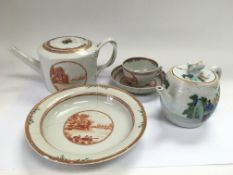 An Oriental teapot with matching cup, saucer and b