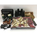 A collection of binoculars, student microscope, cased cutlery etc.