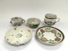An oriental cup and saucer with overlaid floral de
