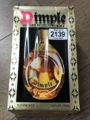 A boxed bottle of Dimple DeLuxe Scotch Whisky