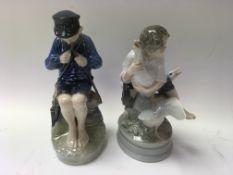 Two Royal Copenhagen figures boy with fishing rod