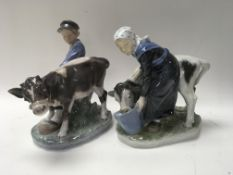 Two Royal Copenhagen figures with cows .
