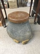 An elephant's foot storage box and foot stool.