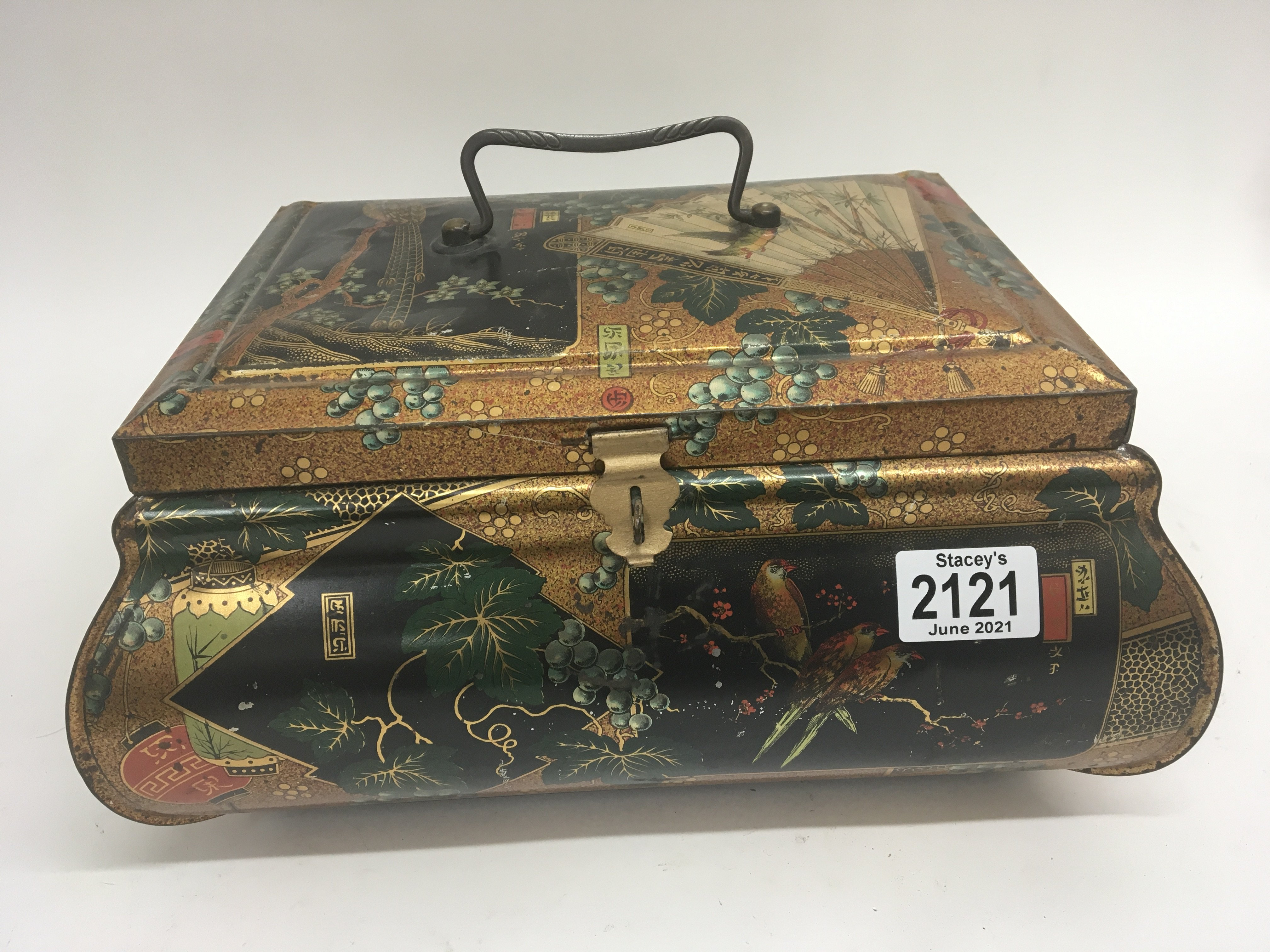 An elaborate Chinese style vintage biscuit tin. 32