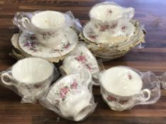 A box containing Royal Albert tea set comprising cups and saucers and side plates
