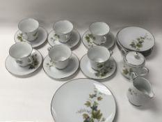 An RC Noritake porcelain tea set. 6 tea cups, 6 sa