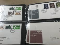 A collection of six Albums of Great Britain first day covers and 3 empty Albums.