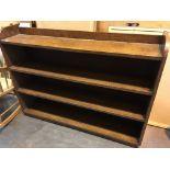 An oak open bookcase with fixed shelves.length 126cm Hight 98cm