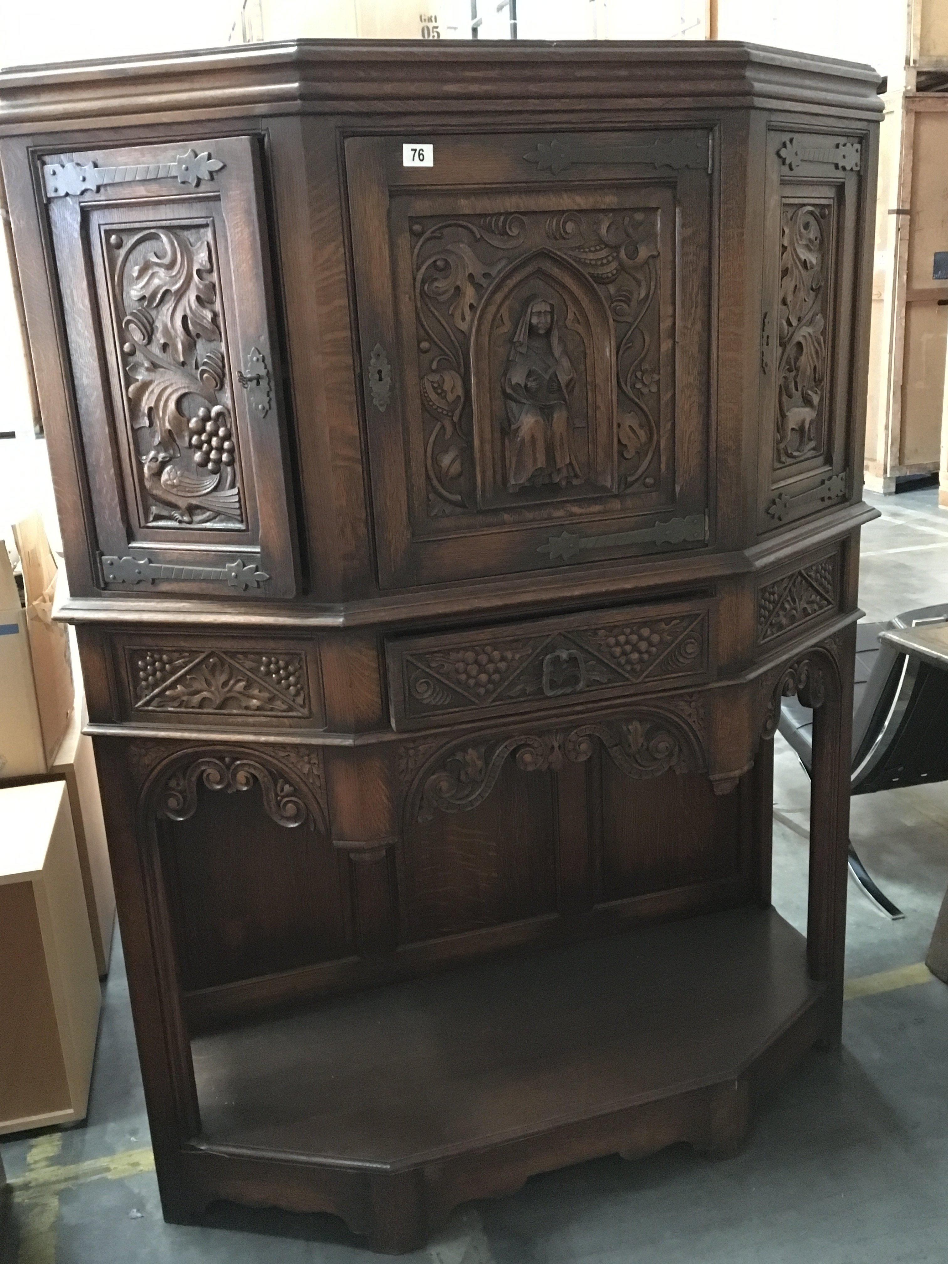 A Quality carved oak cabinet with panel doors above drawers with a carved frieze and open base Hight