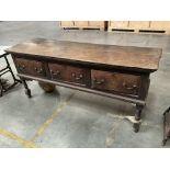 A large early oak dresser base with brass swing handles. 193 x 80 x 58cm.