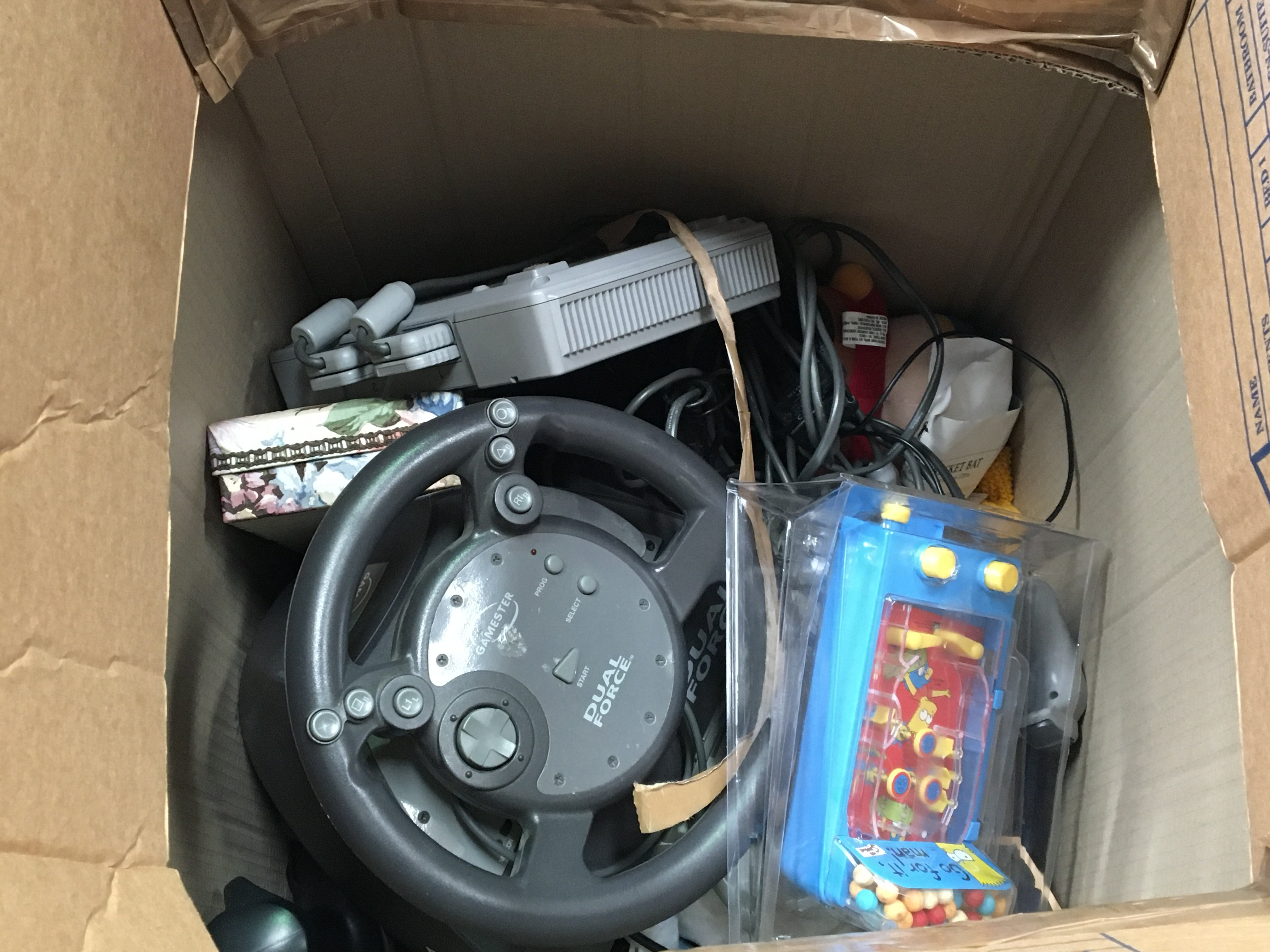 Three boxes containing vintage computer games including a PS1 and other Intendo wii and music CDs
